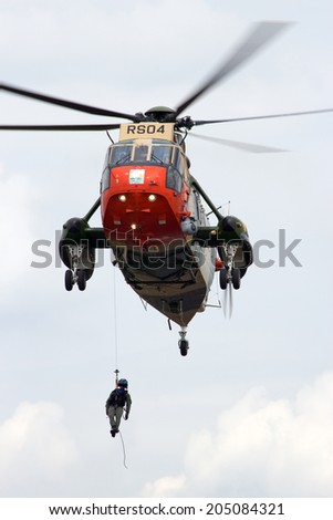 GILZE-RIJEN, THE NETHERLANDS - JUNE 20: Belgian Navy Sea King rescue helicopter performing at the Dutch Air Force Open Day on June 20, 2014 in Gilze Rijen, The Netherlands  - stock photo
