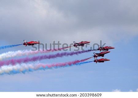 GILZE-RIJEN, THE NETHERLANDS - 21 JUNE: Five jets from  Team the red arrows in action during the royal airforce days June 21,2014 in Gilze-Rijen , The netherlands.  - stock photo