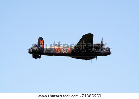 GILZE RIJEN, THE NETHERLANDS - JUNE 18: RAF Historical flight Lancaster WW2 plane flying on the Royal Dutch Air Force Open House. June 18, 2005 in Gilze-Rijen, The Netherlands - stock photo