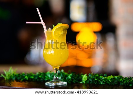 Gin and lime cocktail with pineapple juice and served ice cold bartender - stock photo