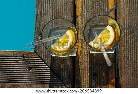 Gin and tonic cocktail on poolside bar - stock photo