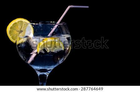 Gin tonic against black background - stock photo