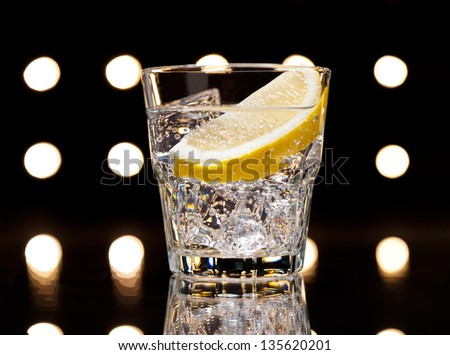 Gin Tonic Tom Collins on the dance floor - stock photo