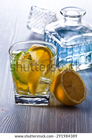 gin with tonic ,  lemon and ice on  old wooden table - stock photo