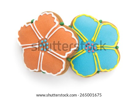 Ginger biscuits in the shape of two flowers painted confectioners