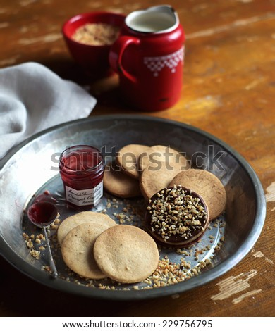 Ginger bread christmas cookies with chocolate frosting and cranberry jam - stock photo