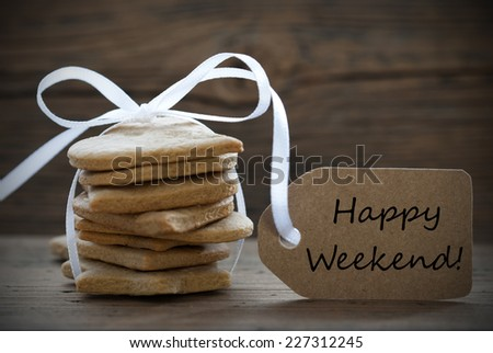 Ginger Bread Cookies with white Ribbon and Label on which Happy Weekend stands - stock photo