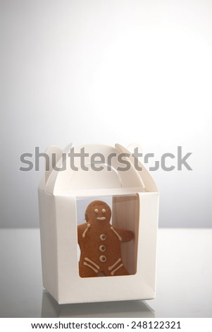 ginger bread man in the paper container - stock photo