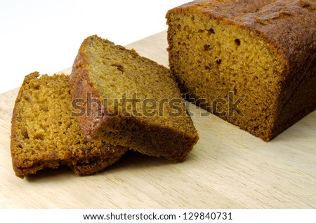 ginger cake slices on board - stock photo