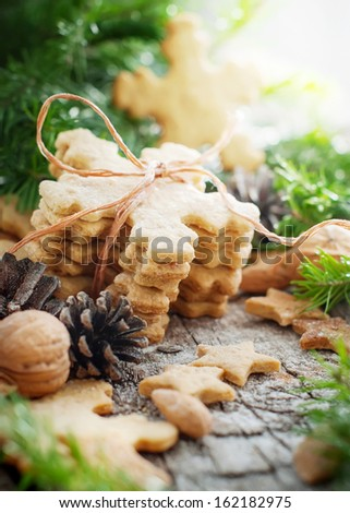 Ginger Cookies in shape of Snowflakes on Christmas Table - stock photo
