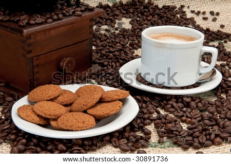 Ginger cookies with espresso coffee and an old coffee grinder. - stock photo