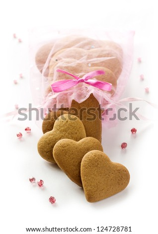 Ginger Heart shaped cookies for Valentine's or Wedding Day in pink Present bag. Isolated on white background - stock photo