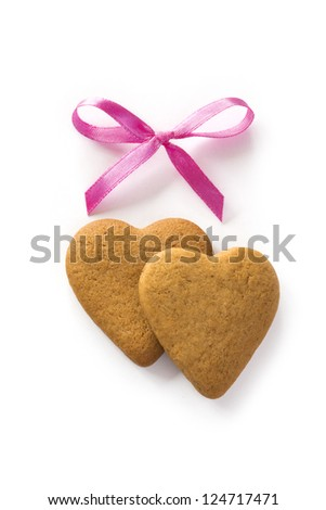 Ginger Heart shaped cookies for Valentine's or Wedding Day with pink bow. Isolated on white background - stock photo