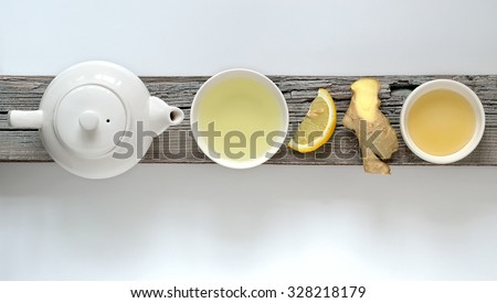 Ginger lemon tea concept, top view with some free space - stock photo