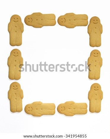 Ginger man cookies Christmas background on white  - stock photo