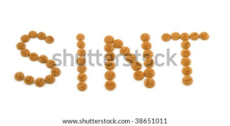 Ginger nuts, pepernoten, in the shape of word Sint isolated on white background. Typical Dutch candy for Sinterklaas event in december.
