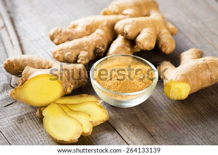 Ginger on wooden table   - stock photo