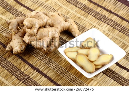 Ginger pieces on mat background - stock photo