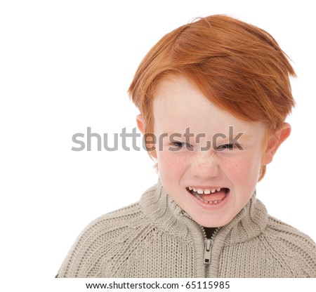 Ginger red hair haired boy funny face isolated on white