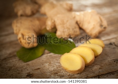 Ginger root slices on rustical wooden table