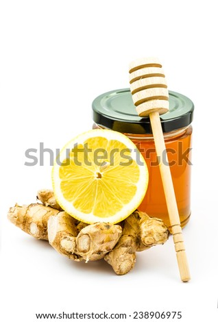 ginger root with halved lemon  - stock photo