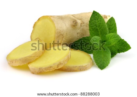 Ginger root with peppermint - stock photo