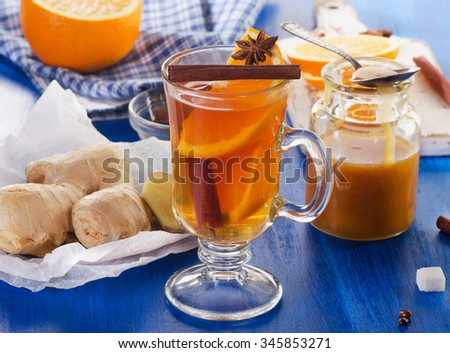 Ginger tea in a glass cup. Selective focus