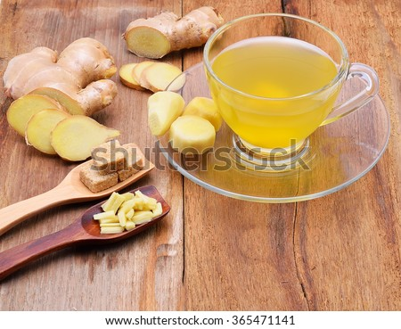 Ginger tea  on wooden table - stock photo