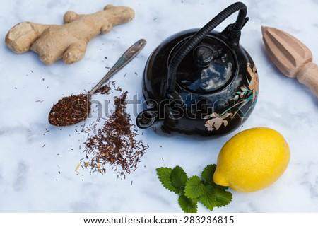 Ginger tea with lemon and mint on marble table, top view - stock photo