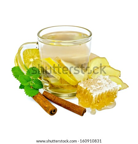 Ginger tea with lemon in a glass mug, mint, cinnamon, ginger root, honeycomb isolated on white background - stock photo