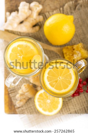 Ginger tea with lemon on a wooden table - stock photo