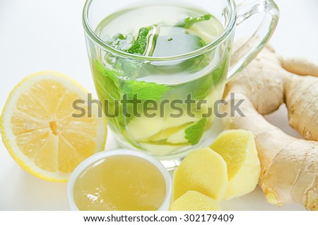 Ginger tea with mint and lemon on table