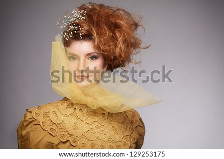ginger woman in retro concept looking at camera - stock photo