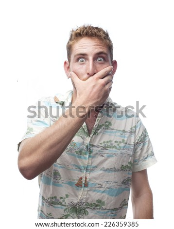 ginger young man with hawaiian shirt covering mouth - stock photo