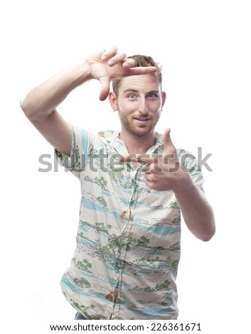 ginger young man with hawaiian shirt frame with his hands