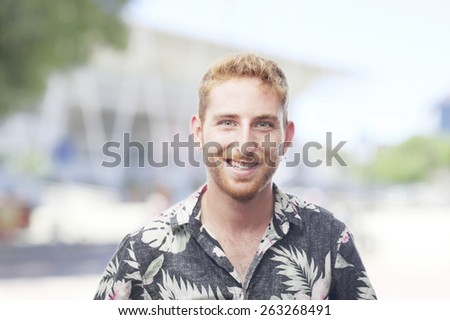 ginger young man with hawaiian shirt happiness