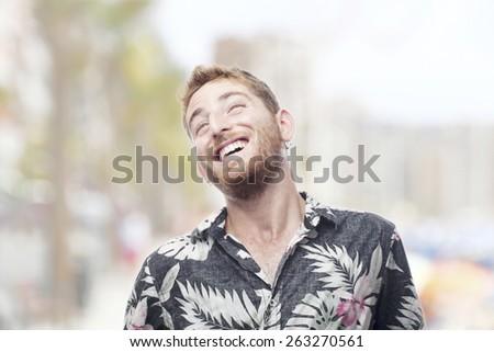 ginger young man with hawaiian shirt laughing - stock photo