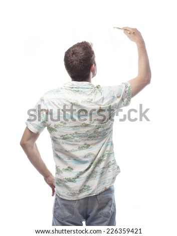 ginger young man with hawaiian shirt with a brush - stock photo