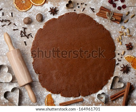 Gingerbread baking dough with spices, cookie cutters and rolling pin, view from above - stock photo