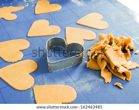 Gingerbread baking on blue nonstick silicone mat - stock photo