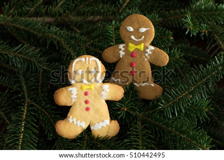 Gingerbread black boy and white girl on  christmas tree background