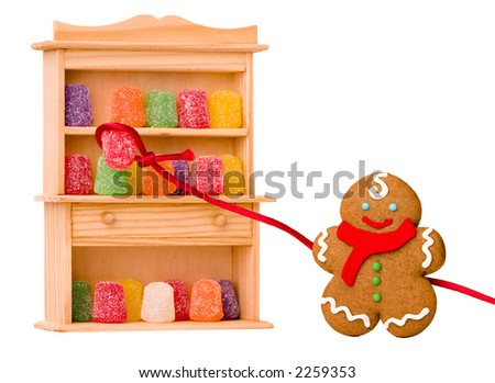 Gingerbread Boy ~ Sneaking Sugar Gumdrops -Includes Clipping Path - stock photo