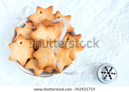 Gingerbread Christmas cookies on white napkin with silver ribbon for winter holidays - stock photo