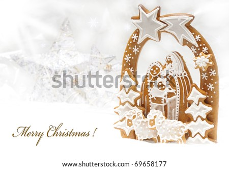 Gingerbread Christmas crib on snow with star background, - stock photo