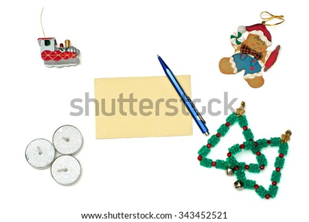 Gingerbread Christmas toy, Christmas trees, train and three silver candles with greeting card over white - stock photo