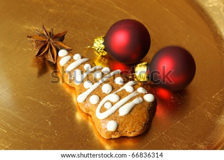 Gingerbread Christmas tree with star anise and red baubles - stock photo