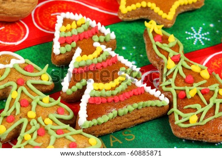 Gingerbread Christmas trees cookies with colorful decoration