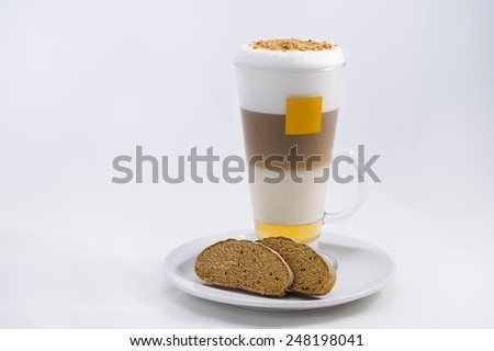 Gingerbread coffee with a couple pieces of sliced gingerbread.