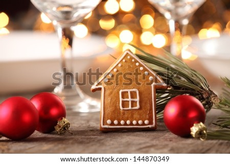 Gingerbread cookie and decorations on holiday table. - stock photo
