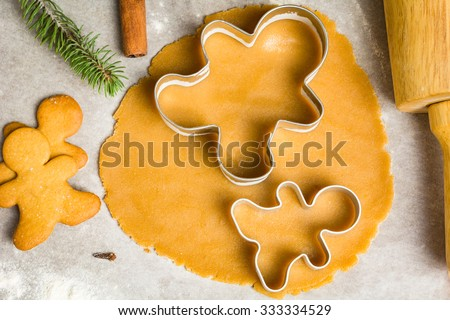 Gingerbread cookie dough and christmas cookie cutters. Baking holiday cookies - stock photo